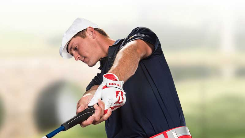 Bryson Dechambeau Swinging Golf Club
